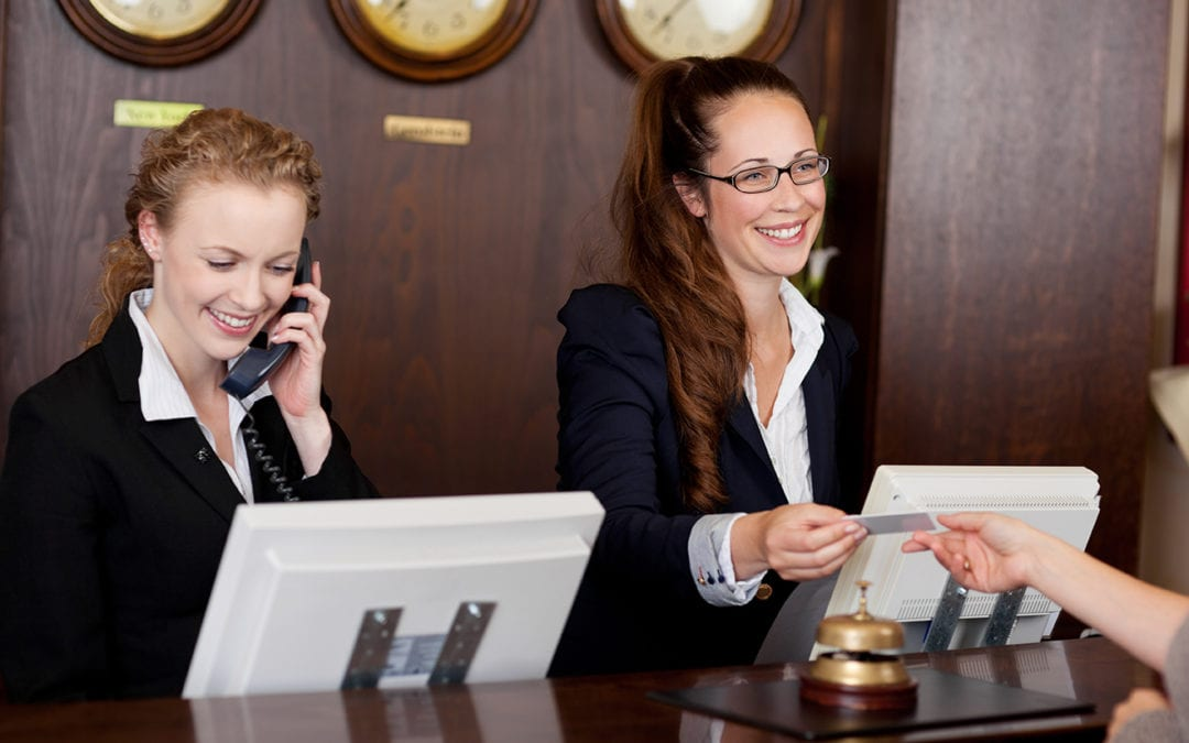 two concierge employees at their desk