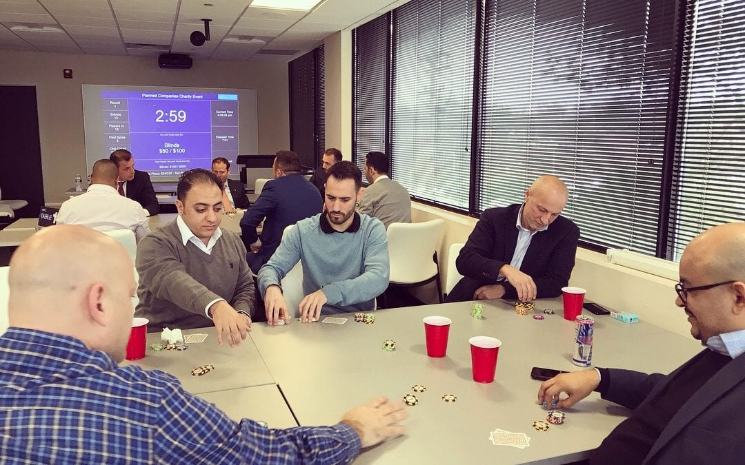 Planned employees at a charity poker event
