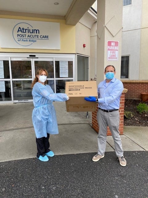 Robert Francis of Planned donating protective masks to Atrium Post Acute Care